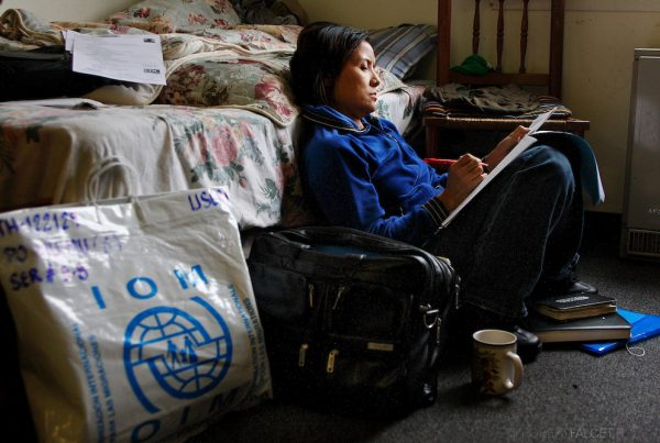 Drucie Bathin, 42, a case worker for the International Institute of Connecticut is a native Karen who is helping her people in their relocation in the United States. Bathin is shown here filling out paperwork for one of the refugee families.    (Photo by Robert Falcetti)